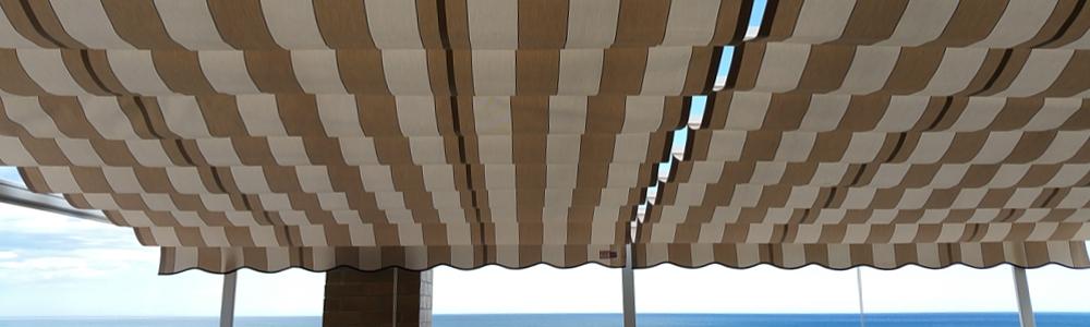 Toldo terraza con portería